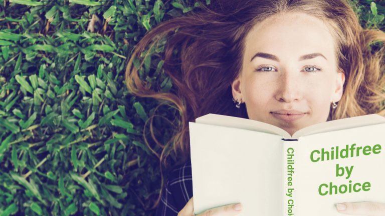 """Woman Lying On Grass Holding A Book In Front Of Her Face That Reads: """"Childfree By Choice"""""""