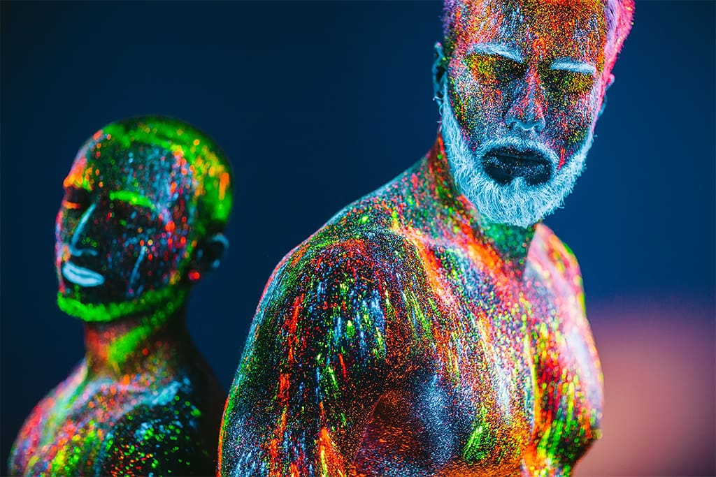 Image Of Two Men In Ultraviolet Powder Signifying Soulmates