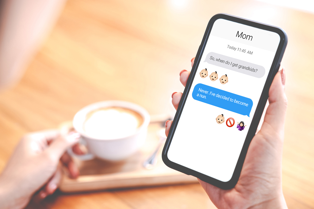 Hand Holding A Mobile Phone Showing Text Messages Between A Mom Wanting Grandkids And A Childfree Woman