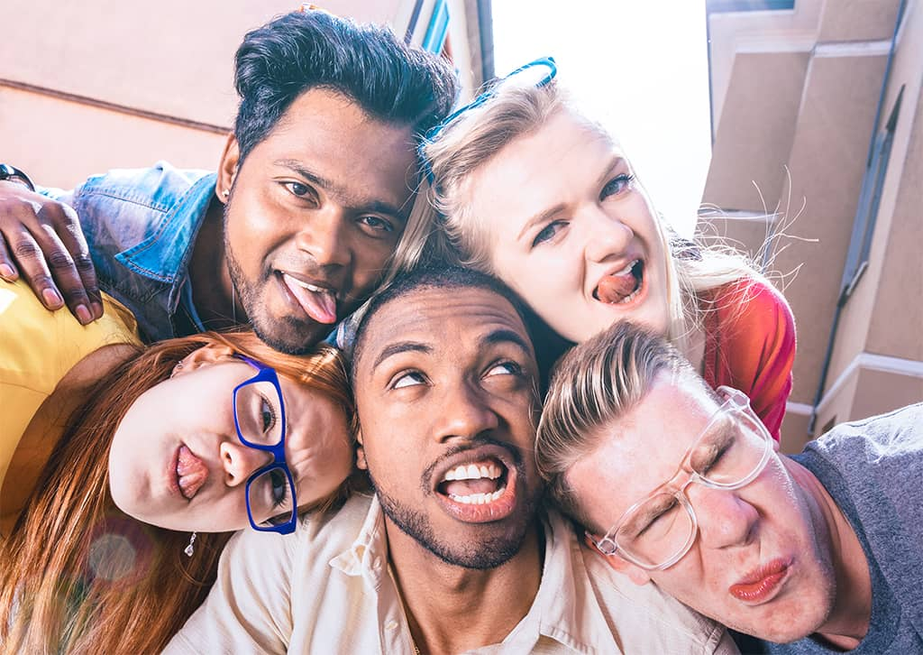 A Group Of Happy College Students Making Funny Faces For A Selfie