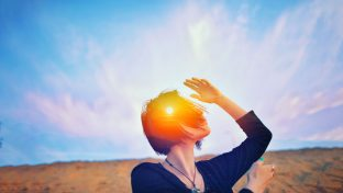Head And Shoulders Photograph Of Woman Dancing On Beach With Sunrise Superimposed Over Her Head, Enlightenment Concept