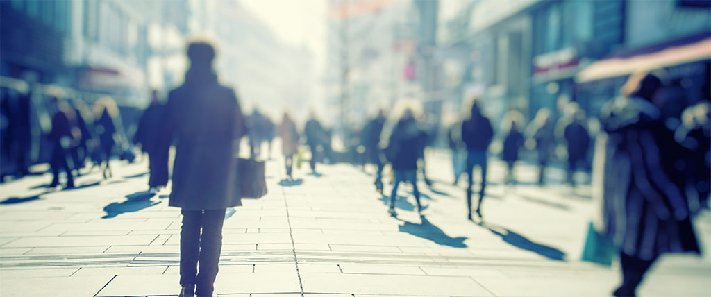 Blurry Photograph Of People Walking On A Busy City Street